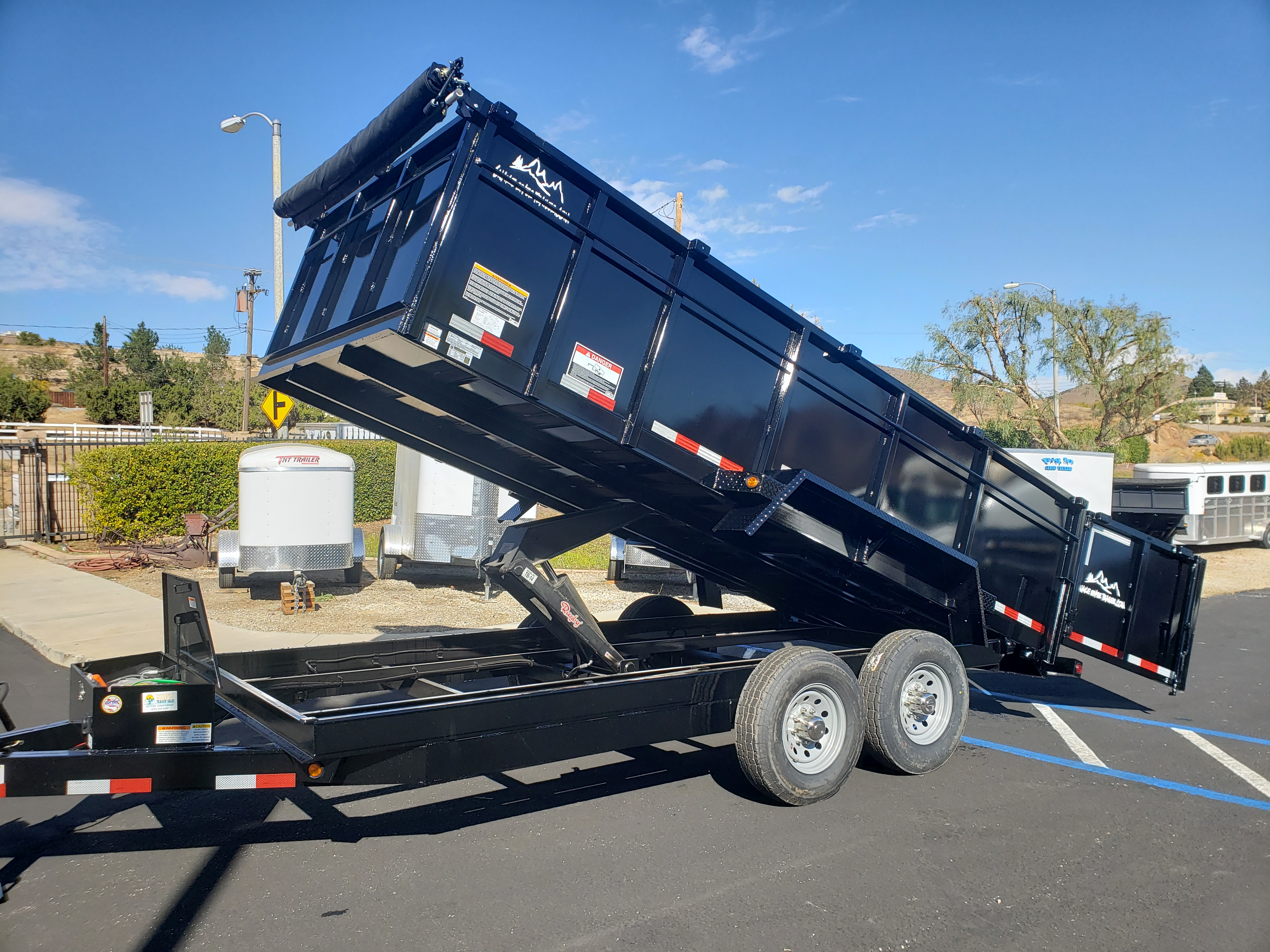 Snake River 7x16 Dump 3ft - Driver side front 3/4 view bed lifted