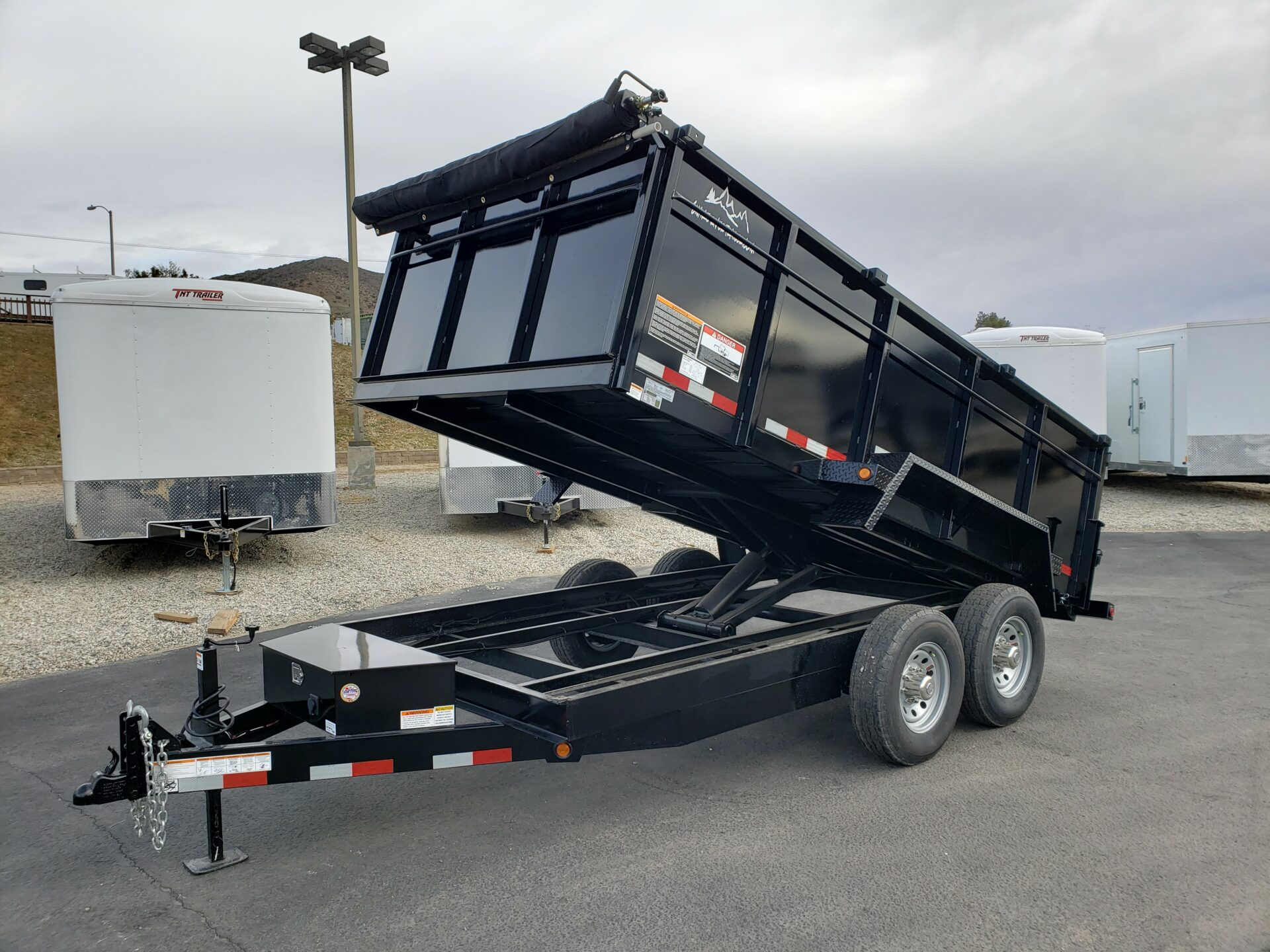 Snake River 7x14 Dump 3ft - Driver side front 3/4 view dump bed up