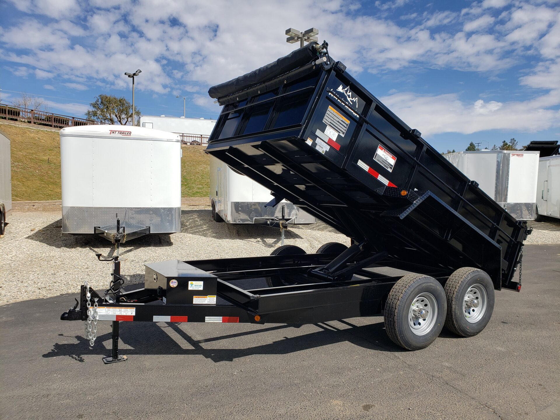 Snake River 7x12 Dump 2ft/SG - Driver side front 3/4 view bed up