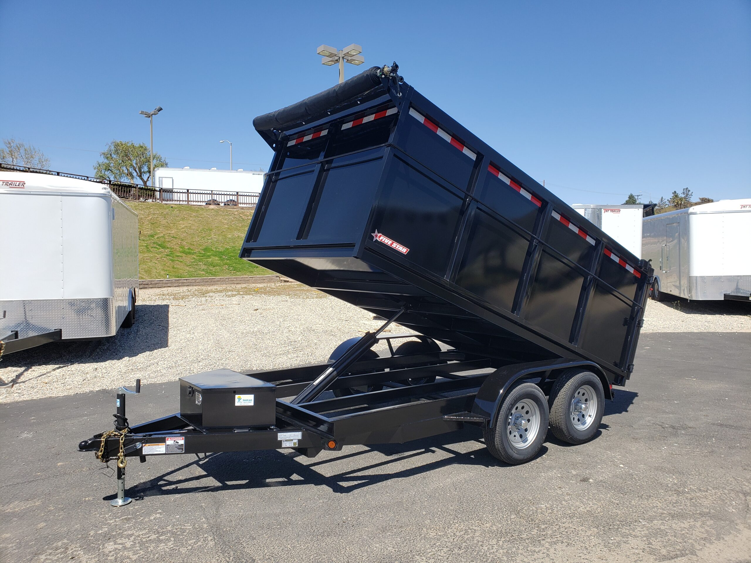 Five Star 6.5x12 7k Dump4ft - Driver side front 3/4 view bed dumped