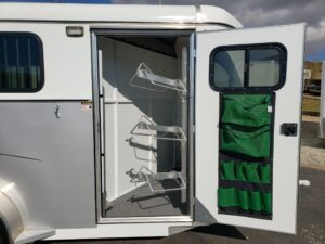 Maverick 3-H Deluxe D/D - Looking into tack room door with saddle rack swung out