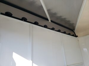 Bridle and rein hooks in tack room