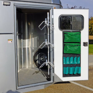 Maverick Lite 3-H Dlx - Looking into tack room and swing out saddle rack