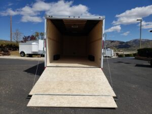 Wells Cargo 24FT RFV-Nose 10K - Looking into rear of trailer and at open ramp door