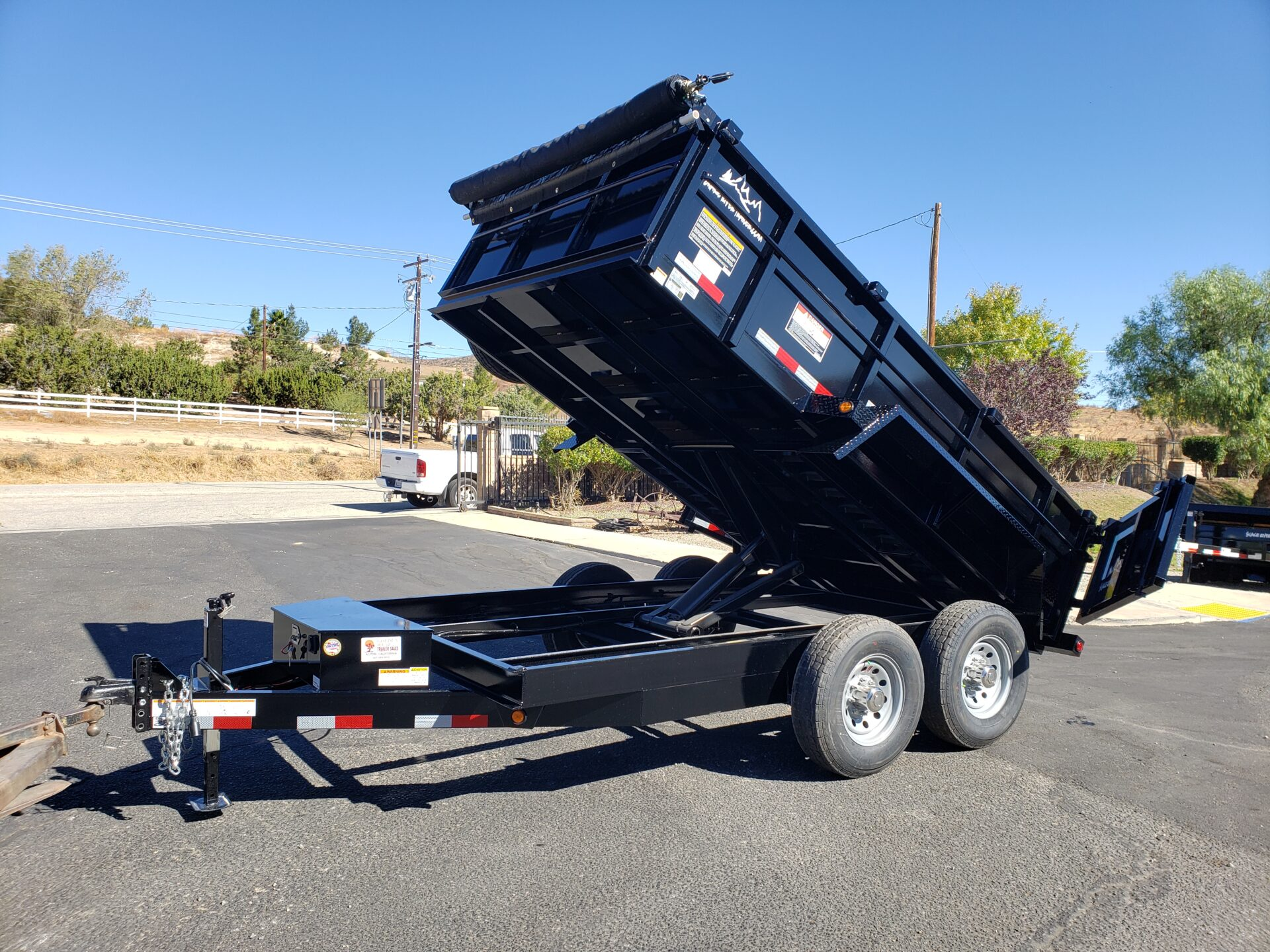 Snake River 7x12 Dump 2ft/14 - Driver side front 3/4 view bed dumped