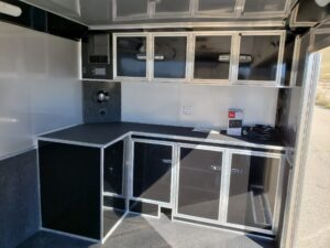 Wells Cargo 24FT MT Race - Shows cabinets, work bench, stereo and sub-woofer