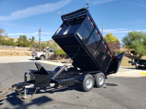 Five Star 5x10 10K Dump4ft - Driver side front 3/4 view bed dumped
