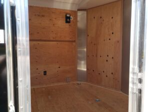TNT 8.5x16 V-Nose SPCL. - View from side door into interior of electrical outlet & breaker panel