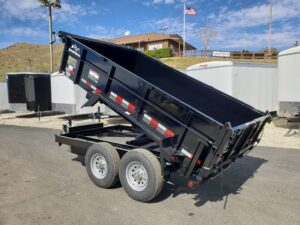 Snake River 7x12 Dump 2ft/SG - Driver side rear 3/4 view bed up