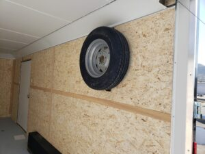 Wells Cargo 8.5x20 RFV7K Blk - Looking in rear at wall mounted spare