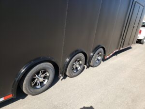 Wells Cargo MotorTrac - Shows triple axle with mag wheels