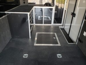 Looking at under floor spare tire storage and tie downs