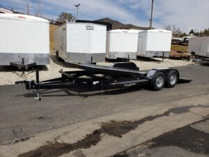 Eliminator 10K Tilt Hauler - Driver side front 3/4 view bed tilted