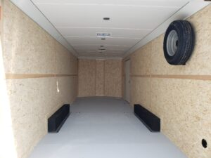 Wells Cargo 24FT RFV-Nose Black - Looking into rear interior showing painted floor and lined ceiling