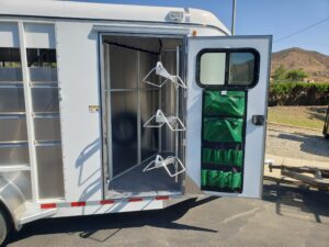 Maverick 3-H Highside SRD - View of tack room & swing out saddle rack