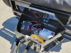 View of tool box showing pump, battery & charger