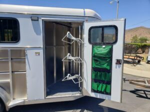 Maverick Lite 3-H DLX - View of tack room door opened, & sadlle rack swung out