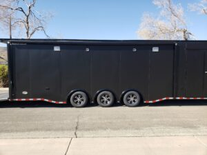 Wells Cargo MotorTrac - Shows passenger side lighting, speakers and awning